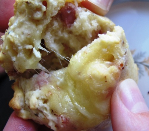 Ham and cheese muffin being pulled apart