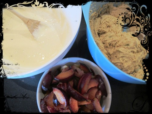 Flour mixture and cream cheese mixture in seperate bowls, and cut up plums in a third bowl.