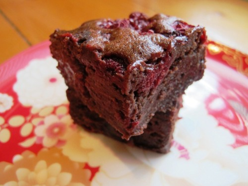 Two slices of raspberry brownie on a plate