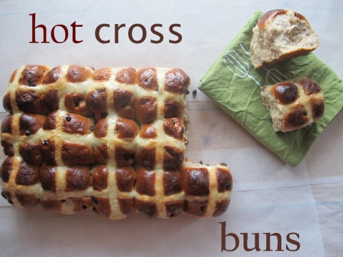 A loaf of hot cross buns, two rippled off