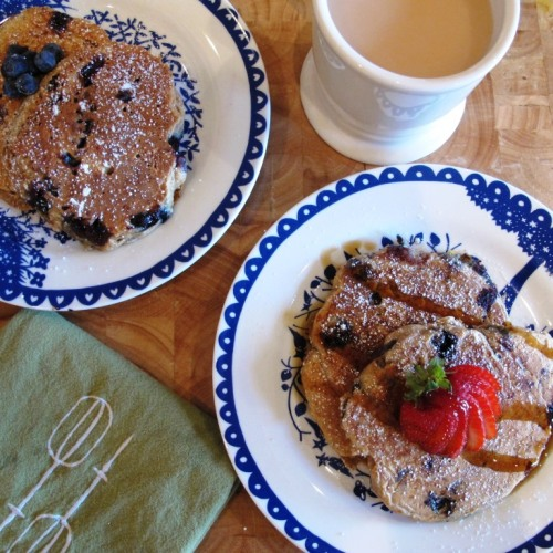 Healthy blueberry bran pancakes with a cup of tea