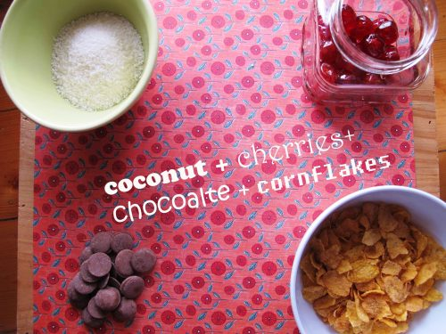 Coconut, chocolate, cherries and cornflakes on a table