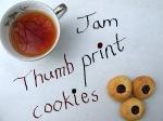 Jam thumbprint cookies with a cup of tea